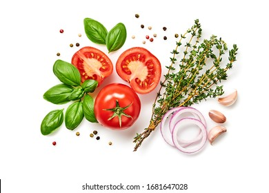 Tomato, basil, spices, pepper, onion, thyme. Vegan diet food, creative composition isolated on white. Fresh basil, herb and tomatoes, cooking concept, top view.
