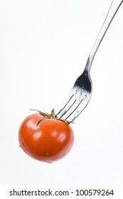 Tomato cherry on a fork. Diet