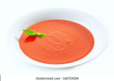 tomato cream soup in white plate