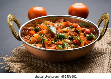 Tomato Curry OR Sabzi also known as Sabji or Chutney served in Karahi,  popular indian vegetable menu for main course. selective focus
