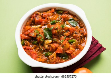Tomato Curry OR Sabzi also known as Sabji or Chutney served in bowl,  popular indian vegetable menu for main course. selective focus