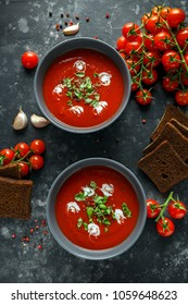 Tomato and fresh basil soup with garlic, cracked papper corns, served with cream and sourdough bread