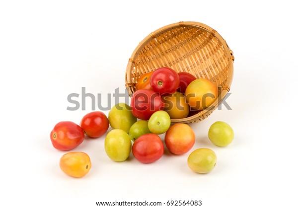 Tomato fruits on white background.