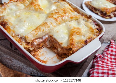 Tomato and ground beef lasagne rolls with cheese layered between sheets of traditional Italian pasta