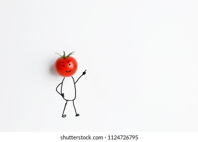 tomato with hand drawing shapes of man