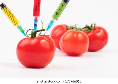 Tomato injection with colorful syringes