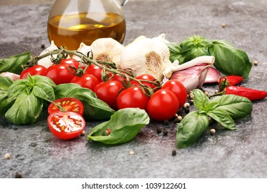 tomato and italian ingredient. Ripe tomatoes with fresh basil, garlic and other herbs