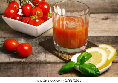 tomato juice with fresh  tomatoes bunch