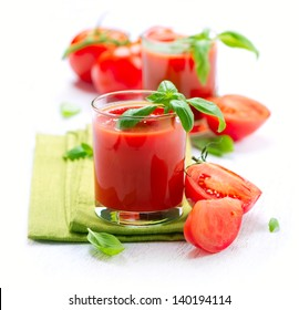 Tomato Juice and Fresh Tomatoes isolated on a White Background