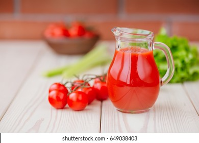 Tomato juice in a glass jar on wooden table. Love for healthy raw food concept.