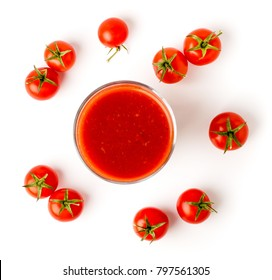 Tomato juice in glass and tomatoes on a white background.
