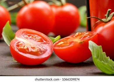 Tomato juice with vegetables and basil on wooden background