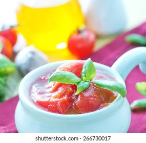 tomato in juice and in the white bowl