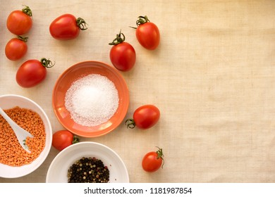 Tomato ketchup sauce with garlic, spices and herbs with cherry tomatoes in a glass bowl, selective focus.