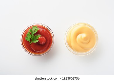 Tomato ketchup tasty and delicious mayonnaise in glass bowl isolated on white. Mock up. Isolated on white background.