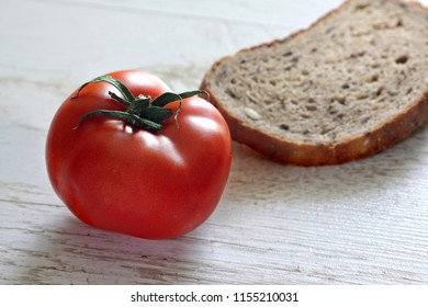 Tomato with a ladle of bread on a table