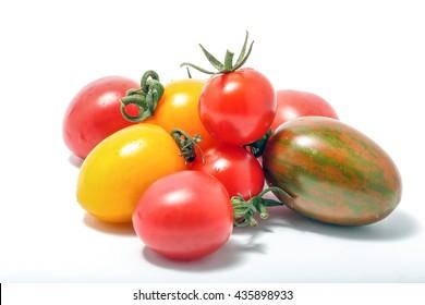 Tomato mixed assorted colorful fresh ripe on white background