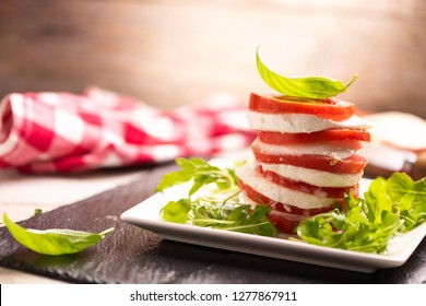 Tomato and Mozzarella slices with basil leaves