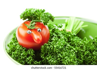 tomato with a nose on the plate and the green isolated on white