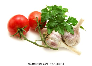 Tomato, parsley leaves, garlic bulbs, isolated on white background