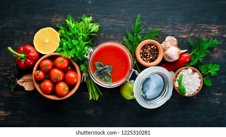 Tomato paste Ketchup with vegetables, homemade. Top view. On a black background. Free space for text.