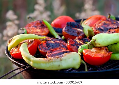 Tomato and Peppers Fish Grilling On BBQ     Fresh Organic Tomato and Peppers Grilling On BBQ in the garden
