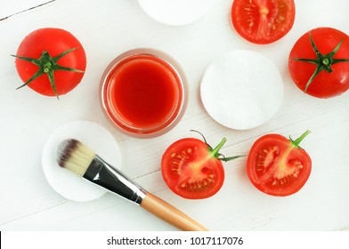 Tomato Pulp Mask Recipe for skin beauty treatment. Homemade vegan mask with fresh juicy red tomato, ingredients viewed above preparation white wooden table.