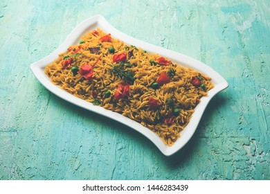 Tomato Rice also known as Tamatar Pilaf/pulav made using basmati rice, served in a bowl. selective focus