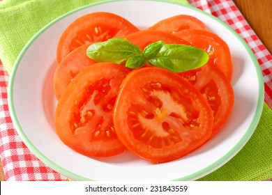 tomato salad with basil on white plate