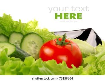 Tomato, salad, cucumber, salad leaf on  dish isolated on white background
