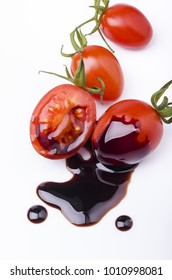 tomato salad dressed with balsamic vinegar glaze