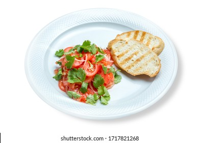 Tomato salad with onions and cilantro. Served with toast.