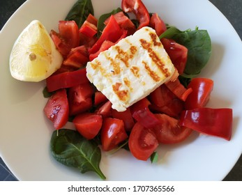 tomato salad with red pepper and halloumi cheese