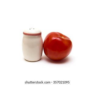 Tomato and salt cellar on a white background
