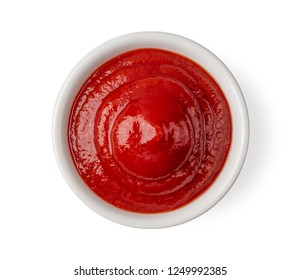 tomato sauce in a bowl isolated on white background. top view