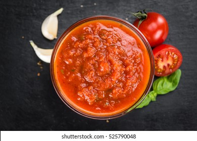 Tomato Sauce on a vintage background as detailed close-up shot (selective focus)