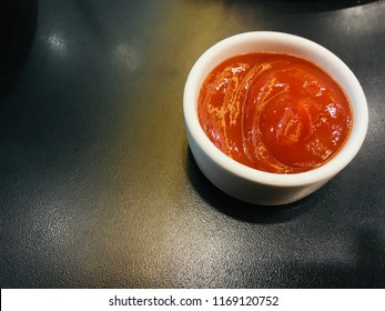 Tomato sauce in small white cups