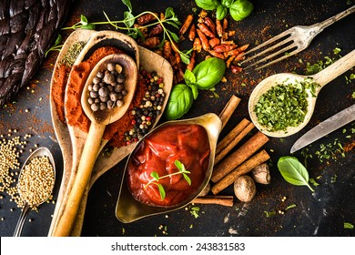 tomato sauce with spices and textured black kitchen table - Shutterstock ID 243831583