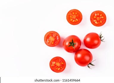Tomato with slice isolated on white background.