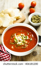 Tomato soup with cheese and pesto sauce