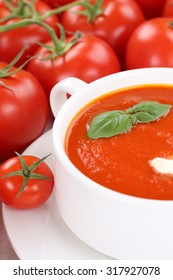 Tomato soup meal with fresh tomatoes and basil in bowl