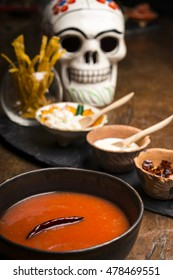 tomato soup with Mexican skull and sauces