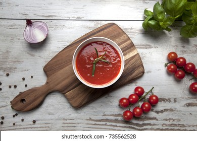 Tomato soup on rustic background