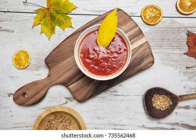 Tomato soup on rustic cbackground