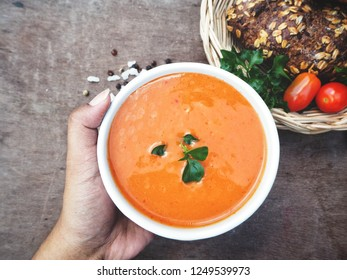 Tomato soup on wood background