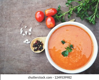 Tomato soup on wood background