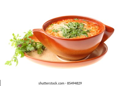 Tomato soup parsley isolated against a white background