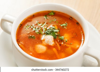 tomato soup with vegetables and meat
