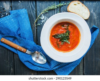tomato soup in a white plate