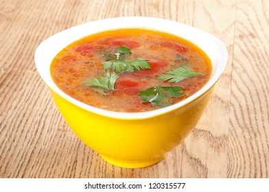 tomato soup in a yellow bowl